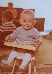 Baby Lucas on a toy chair